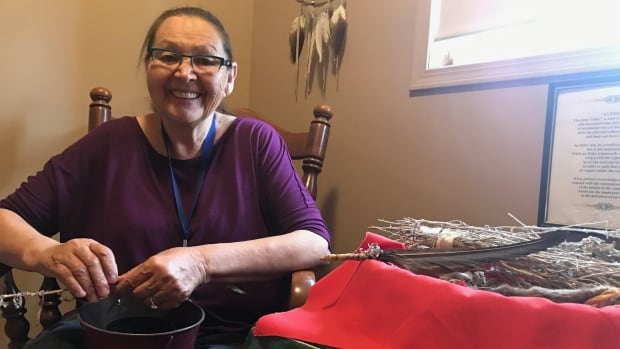 Cultural leader and elder Jackie Bromley sits in the elder's room at the Awo Taan women's shelter in Calgary.  She teaches, smudges and counsels women who use the shelter's services.