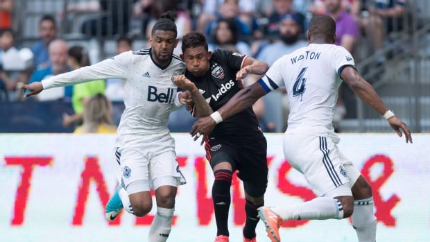 Vancouver Whitecaps defender Sheanon Williams (left) has been suspended indefinitely by Major League Soccer after he was charged with assault.