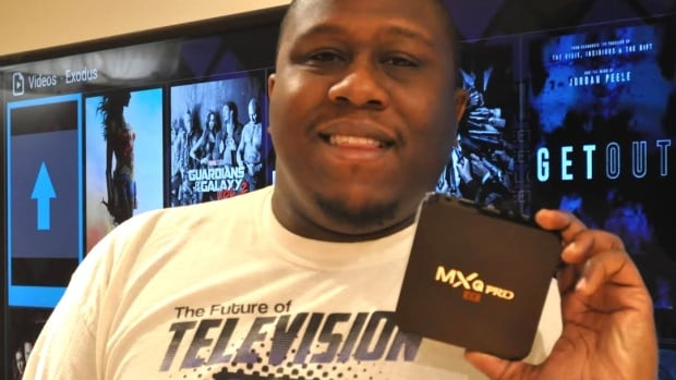 Vincent Wesley in Montreal shows an Android box people use to stream pirated content with the help of special software and apps. Wesley, who used to sell the devices, was named in a lawsuit by cable giants.