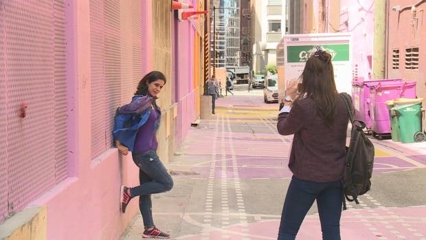 Saba Pakdel gets her photo taken inside Alley-Oop near West Hastings and Granville in Vancouver.