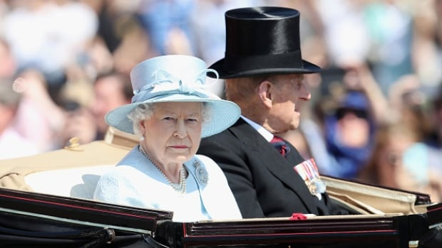 The Queen and Prince Philip, Duke of Edinburgh, travel in the royal carriage during the annual Trooping The Colour parade on Saturday in London to mark her official birthday.