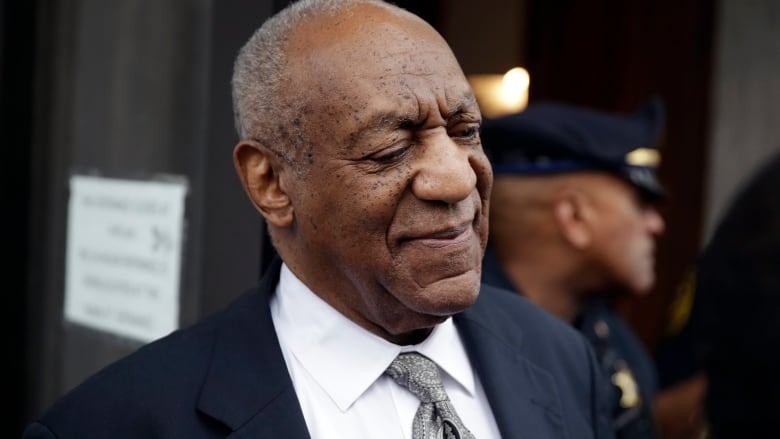Bill Cosby exits the Montgomery County Courthouse after a mistrial in his  sexual assault case on Saturday. (Matt Rourke/The Associated Press)