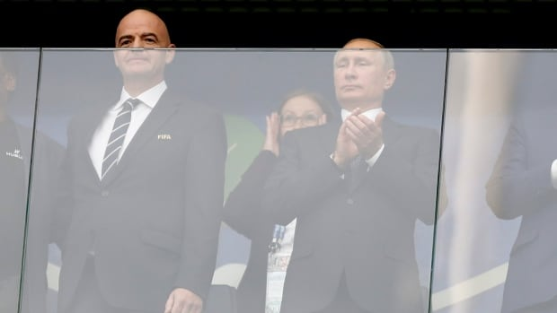 Russian President Vladimir Putin, right, is flanked by FIFA President Gianni Infantino, left, prior to the kick-off of the Confederations Cup, Group A soccer match between Russia and New Zealand at the St. Petersburg Stadium in Russia on Saturday.