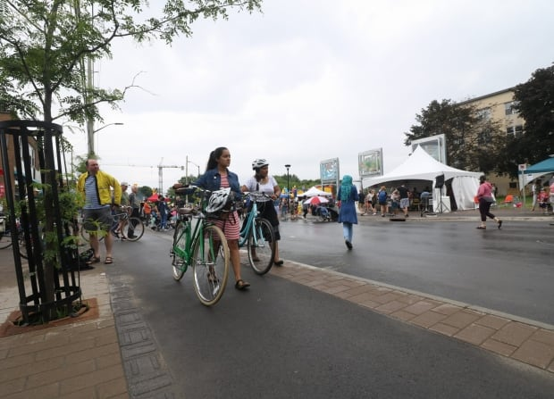 main street reopens complete street cyclists bike path ottawa