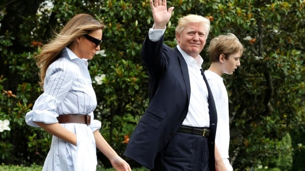 U.S. President Donald Trump with first lady Melania and their son Barron walk out from the White House in Washington before their departure to Camp David on Saturday.