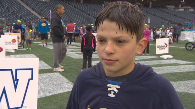 Théo Roy, 11, did the SuperRun in his wheelchair.