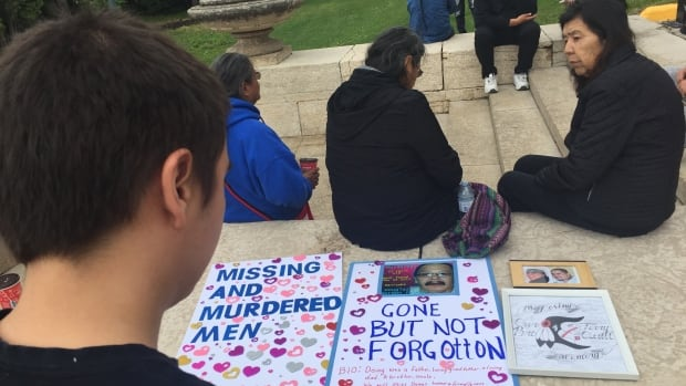 More than a dozen people joined a vigil for Manitoba's missing and murdered men on Sunday.