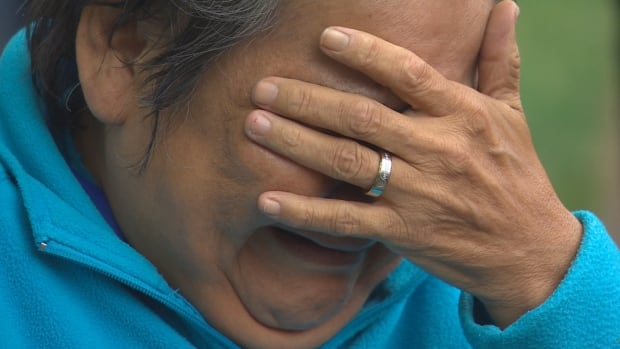 Roseanna Oshawee fights back tears at a vigil for her daughter Sunday.