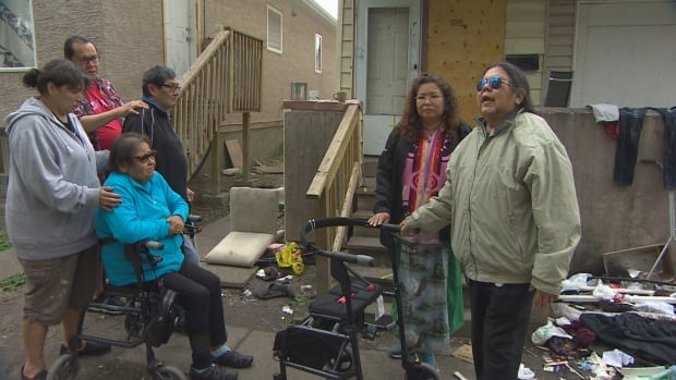 Family and friends of Oshawee's gather on Spence Street to remember her.