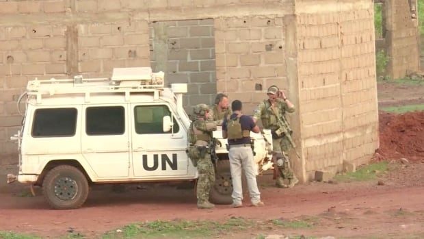 French soldiers stand around a UN vehicle following an attack where gunmen stormed Le Campement Kangaba in Dougourakoro, to the east of the capital Bamako, Mali, on Sunday, June 18, 2017.