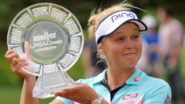 Canada's Brooke Henderson poses with the trophy after winning the Meijer LPGA Classic golf tournament at Blythefield Country Club