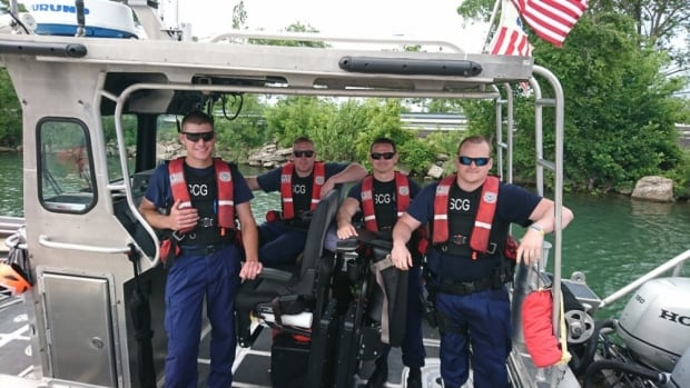 Members of Coast Guard Station St. Clair Shores, Michigan, pose for a photo aboard a response boat at the station after finishing an emergency case where they preformed CPR on a woman going in and out of consciousness while medically transporting her from the boat she was on in the Lake St. Clair to waiting emergency medical services personnel on shore, June 17, 2017.