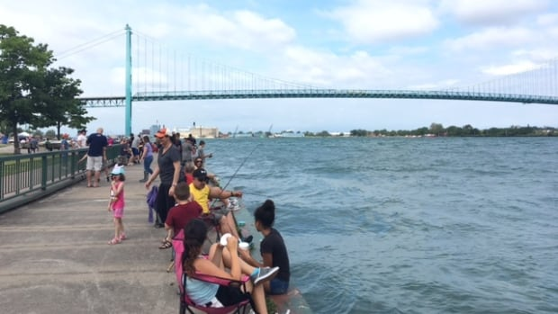 About 200 people showed up to cast a line to try and reel in the big one during the Cops and Kids Fishing Derby on Sunday.
