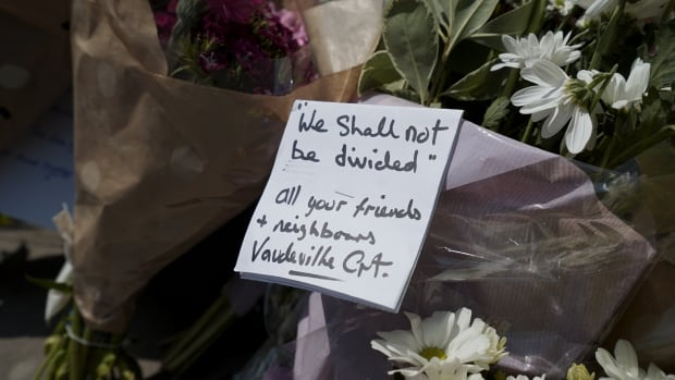 A note at a makeshift memorial outside Finsbury Park Mosque, following Monday's attack. An imam at the Quebec City mosque where a man shot and killed six men in January condemned the attack in London.
