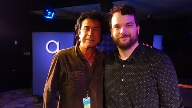 Andy Kim and q host Tom Power