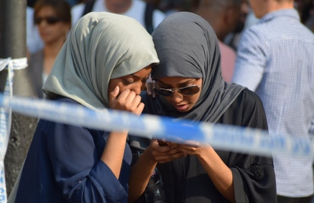 Two girls outside Finsbury Park mosque