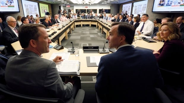 Federal Finance Minister Bill Morneau, centre, along with deputy minister Paul Rochon, left, and deputy governor of the Bank of Canada Carolyn Wilkins, right, meet with provincial and territorial finance ministers in Ottawa.
