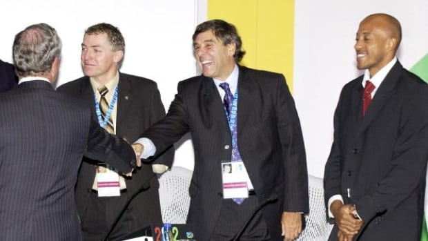 Patrick Jarvis, centre, is making a bid to become the next president of the International Paralympic Committee.