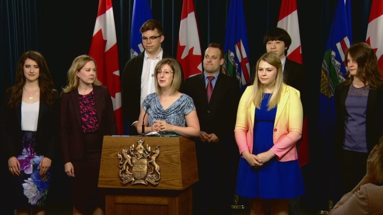 Representatives of groups supporting the Ready for Her campaign joined  Status of Women minister Stephanie McLean, centre, at a news conference  Monday. (CBC)