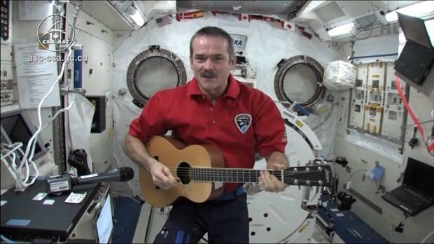 Canadian astronaut Chris Hadfield plays his guitar and sings from the International Space Station.