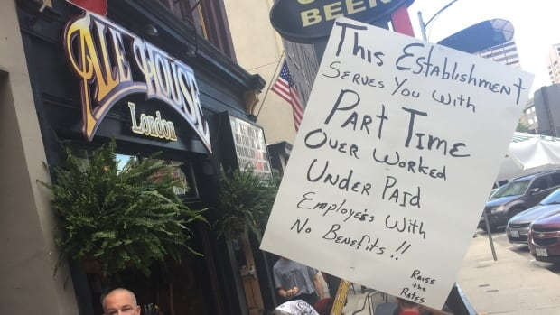 A sign at Monday's protest against the Ale House in London, Ont.