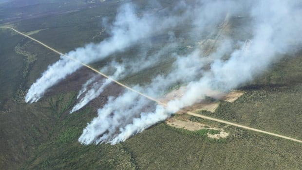 Wildfires burning near the Dempster Highway in Yukon last June. An internal government audit found problems with organization and oversight at the Yukon Wildland Fire Management branch.