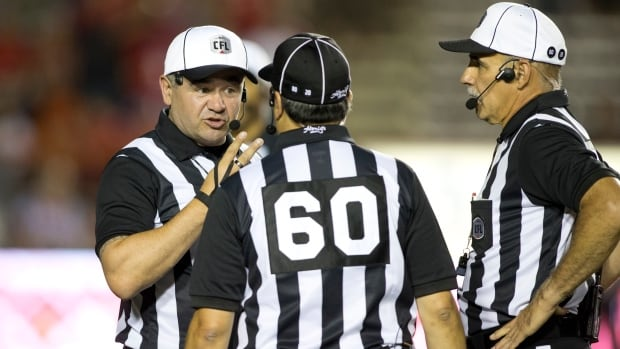 Brian Chrupalo, left, has been a CFL official for 11 seasons, and is also a member of the Winnipeg police force.