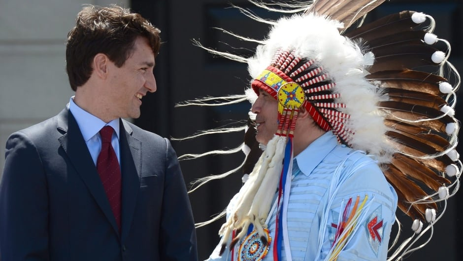 Prime Minister Justin Trudeau, left, and Perry Bellegarde, national chief of the Assembly of First Nations, celebrate the newly named National Indigenous Peoples Day in Ottawa on Wednesday, June 21, 2017.