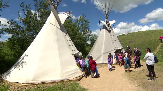 School children explore the teepee village at Wanuskewin Heritage Park on National Aboriginal Day. The park is hosting a cultural showcase Aug. 21-24.