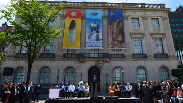 Prime Minister Justin Trudeau speaks during National Indigenous Peoples Day celebrations in Ottawa Wednesday in front of the former U.S. embassy across from Parliament Hill, which will become a space dedicated to Indigenous Peoples.