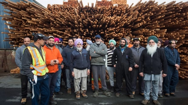 Mill workers like these ones at Partap Forest Products in Maple Ridge, B.C., are waiting to see the amount of anti-dumping duties levied against Canadian softwood lumber by the U.S. Commerce Department Friday. Their industry is one of Canada's most contentious trade files.