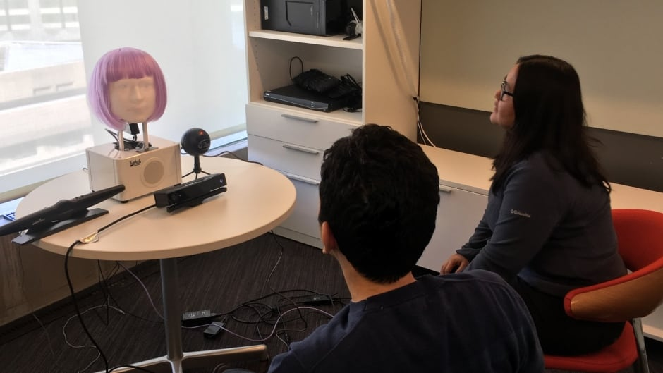 A couple gets counselling from a humanoid robot.