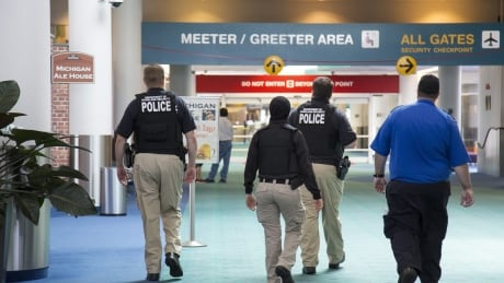 Montreal suspect in Michigan airport stabbing had tried to buy a gun, FBI says