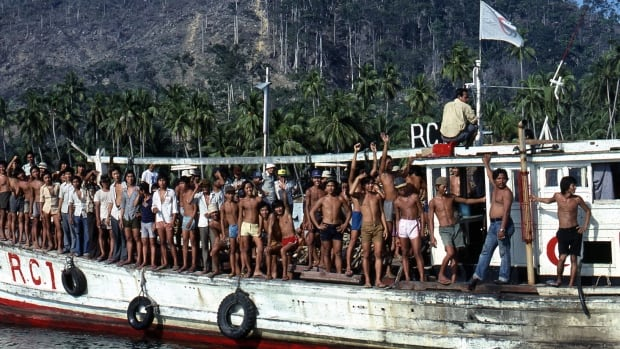 Vietnamese refugees leave Pulau Bidong island in Malaysia in 1979.  A new book celebrates the work of Canadian immigration officers who brought in 70,000 Vietnamese refugees over five years, most of them in the first 18 months.