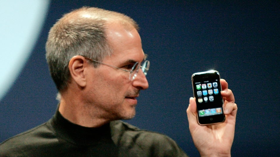 Former Apple Inc CEO Steve Jobs Shows Off The First Generation IPhone On Jan