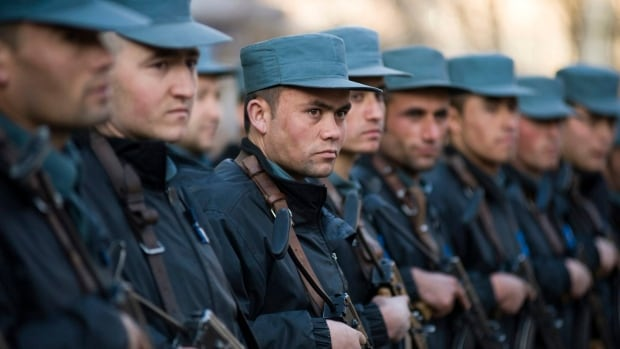 Trainees at the Afghan National Police Academy stand in formation on Feb. 20, 2011, in Kabul, Afghanistan. An Afghan leader has appealed to Canada and NATO for more help with fighting the Taliban.