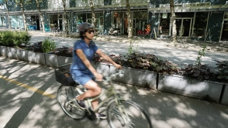 'Part of an evolution': Downtown business partners with cycling group