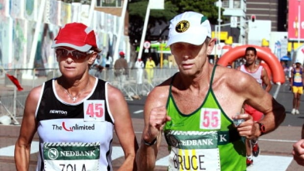 South African distance runner Bruce Fordyce, right, was robbed of his shoes at gunpoint while jogging in Johannesburg.