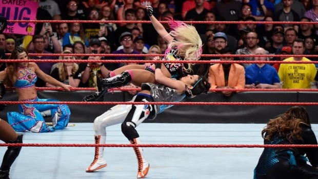 Alexa Bliss, in the black boots, is one of the wrestlers participating in the WWE Live Road to Wrestlemania tour, originally scheduled for February 9 in Edmonton.