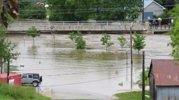 """Access to the Main Street bridge in Grand Valley has been closed, due to high water levels on the Grand River. """"Have never seen the river this high since we've lived here,"""" tweets Darren Maunu."""