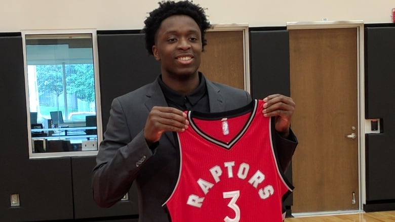 246c6b12f Raptors draft pick OG Anunoby shows off his jersey Friday in Toronto.  (Chicco Nacion CBC)