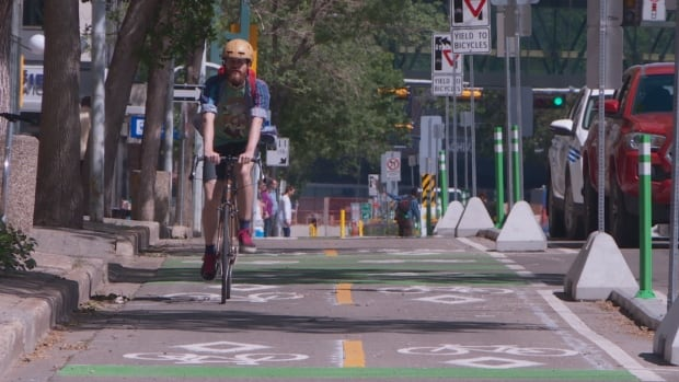 Andrew Ritchie rides along the newly opened protected bike lanes.