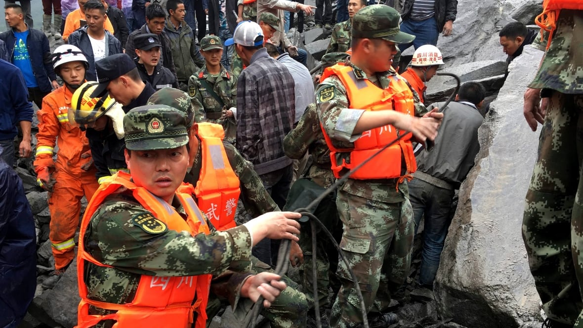 120 people feared buried in China landslide