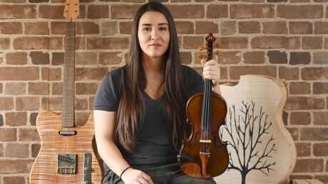 Young Vancouver guitar maker's niche work shines at international show