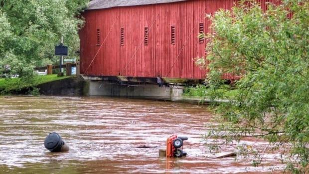 River flow under the Olde Bridge Place, Township of Woolwich. Though northern portions of Grand River under flood watch, river flows are still higher than normal, said GRCA.