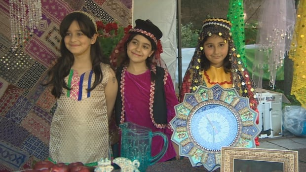 Children display Iranian cultural items at the Tirgan festival in Halifax on Sunday.