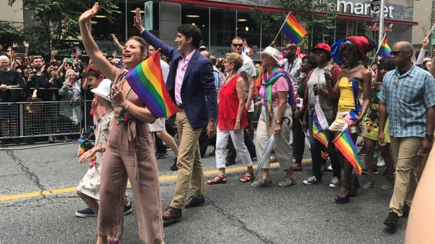 Sophie Grégoire Trudeau, left, and Prime Minister Justin Trudeau walked in the Toronto Pride parade with Ontario Premier Kathleen Wynne, background, and thousands of others.