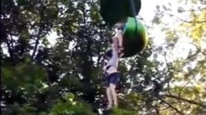 Crowd catches teen dangling from ride