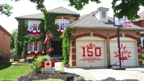 Cambridge woman uses red duct tape to decorate garage doors for Canada Day