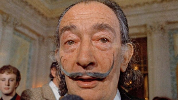 Salvador Dali, seen here in May 1973, died in 1989 at age 85. The remains of the Spanish surrealist were exhumed on Thursday evening in Spain to settle an ongoing paternity suit.